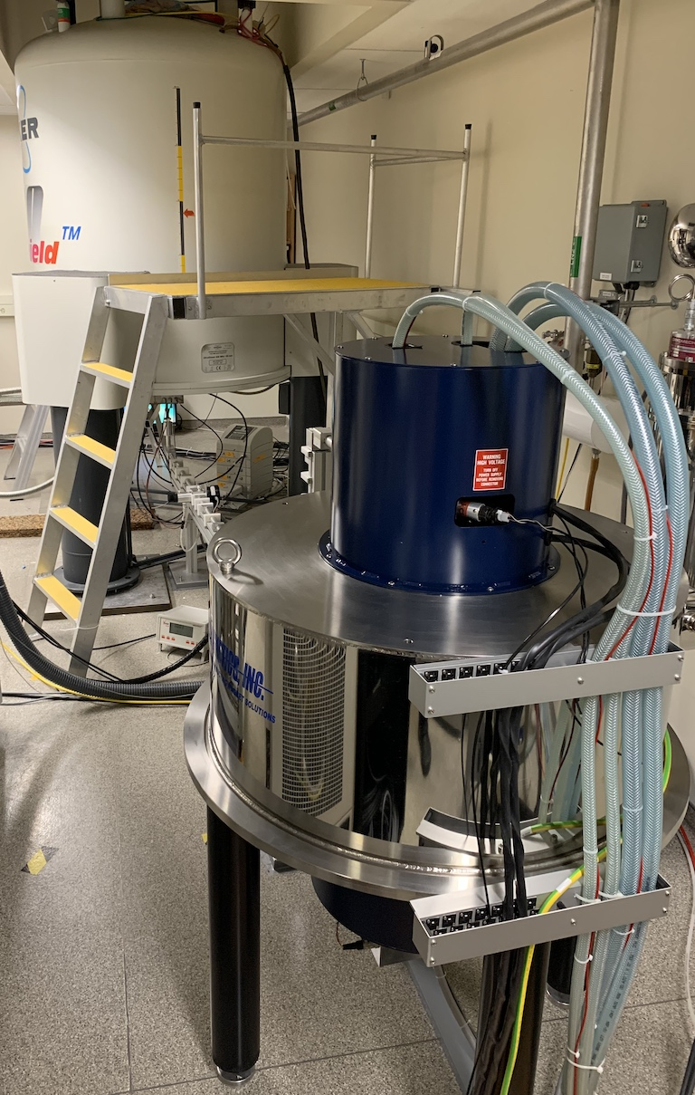 DNP system with gryotron magnet in foreground and NMR magnet in background.