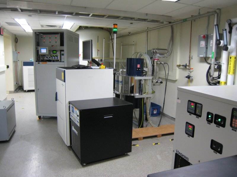 Image of a DNP-NMR system with associated cooling and gyrotron equipment.