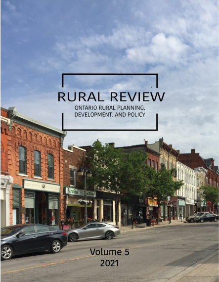 Cover image of volume 5 of the journal Rural Review shows a downtown area with commercial buildings and several cars parked along the street