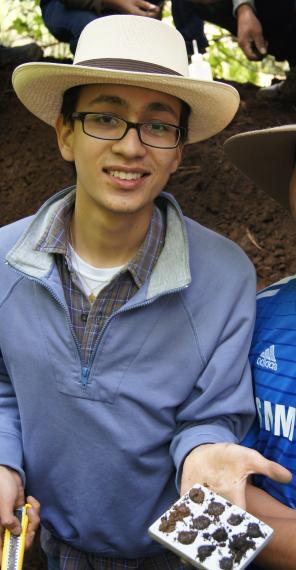 Photo of Fernando holding soil samples.
