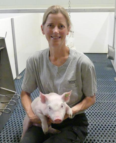 Terri O'sullivan holding a piglet