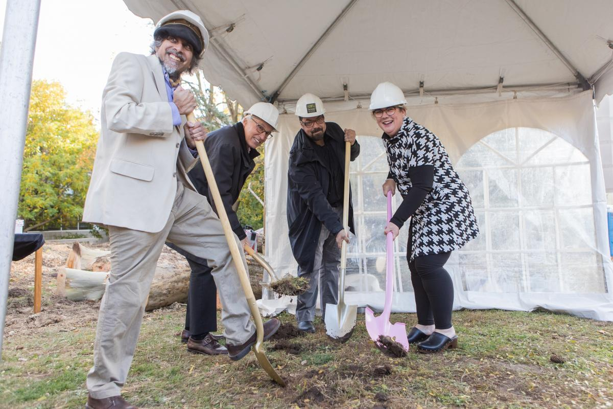 Picture of Ajay Heble, Franco Vaccarino, Dieter Janssen, and Samantha Brennan with shovels