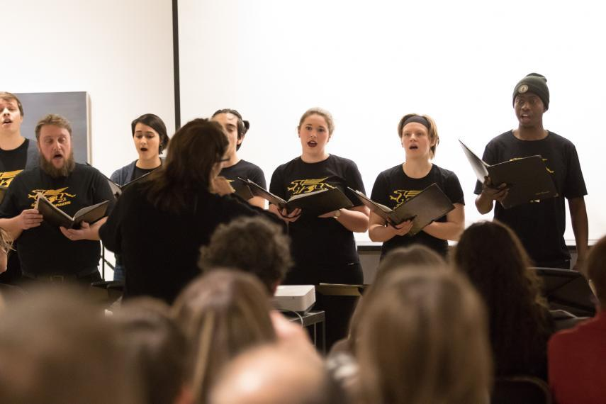Picture of Gryphon Singers singing in front of an audience.