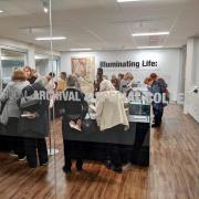Members of the public view the exhibit