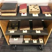 Manuscripts on book cart