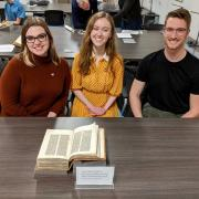 Student curators with manuscript