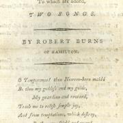 "White cover of a chapbook titled ""Two Songs by Robert Burns of Hamilton""."