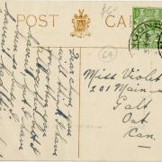 Back of a postcard addressed to Violet with a green stamp and handwriting.