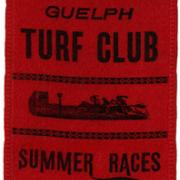 Red Guelph Turf Club Summer Races ribbon with a picture of racing horses in black.