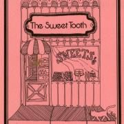 The Sweet Tooth cookbook with pink cover and hand-drawn sweet shop.