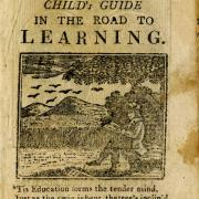 "Cover of an old browning chapbook titled ""Child's Guide in the Road to Learning""."