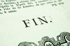 "Image of the french word ""fin"" in book, denoting the end of the text."