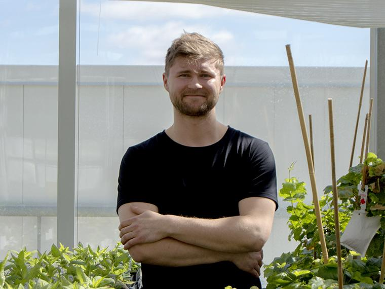 PhD student Michal Pyc in the Phytotron (photo by K. White)
