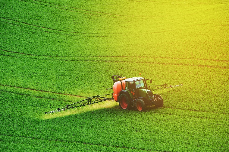 A tractor spraying chemicals