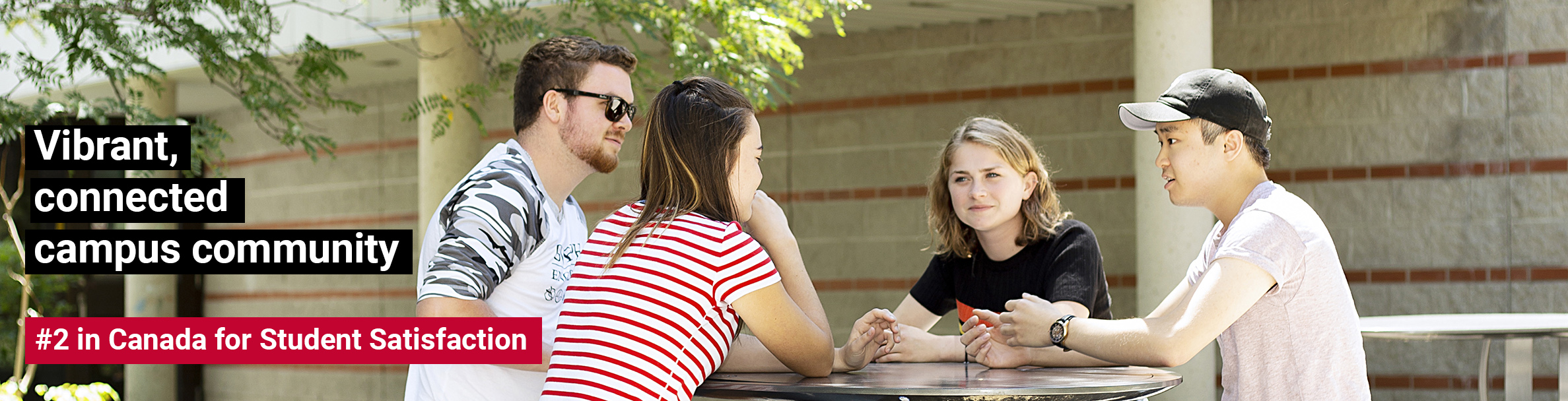 Image of students sitting at table chatting