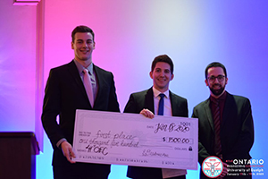 First place winners for Re-Engineering holding check