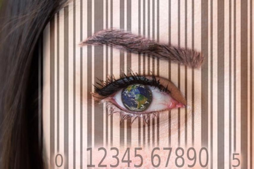 Photograph of a woman's eye with an overlay image of a supermarket barcode.