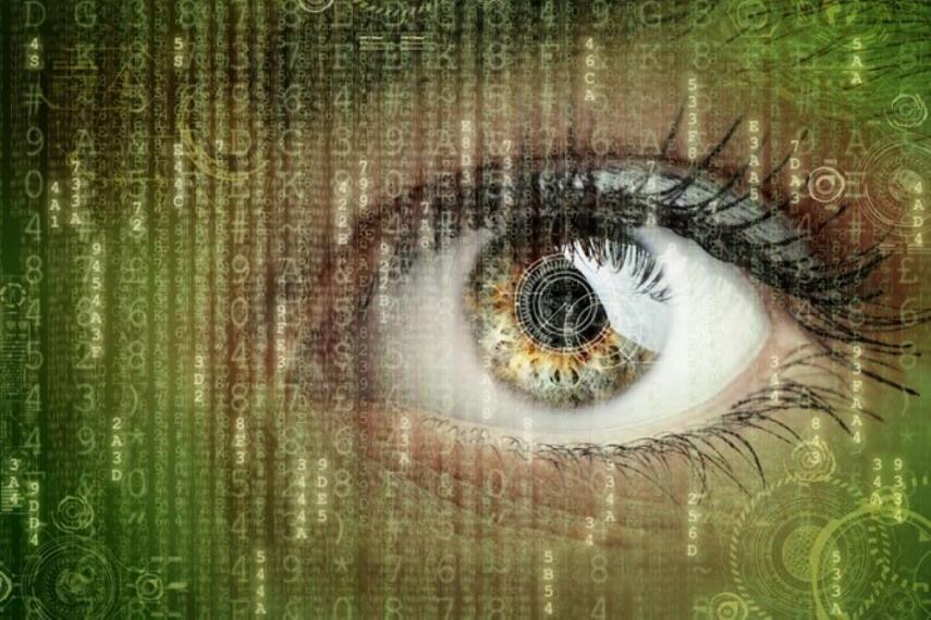 Close-up of eye with computer code overlaid