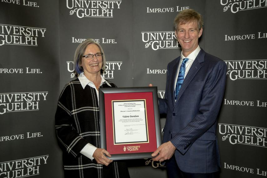 John Runciman presenting Professor Emerita Valerie Davidson with 2019 Director's Award of Distinction