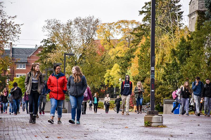 Image of students walking on campus in the fall