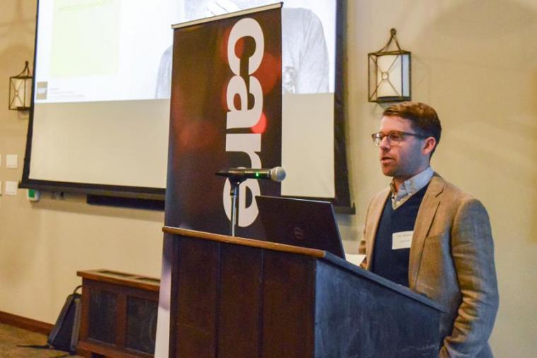 Image of Gus Skorburg speaking at CARE-AI event