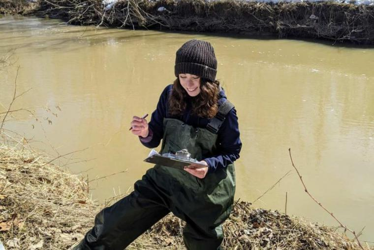 Hannah May conducting field work in watershed
