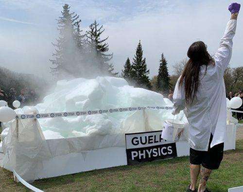 Physicist standing in front of the world record soap bubble foam creation