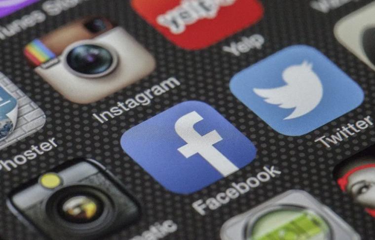 Social media app icons on a screen including Facebook, Twitter, Instagram