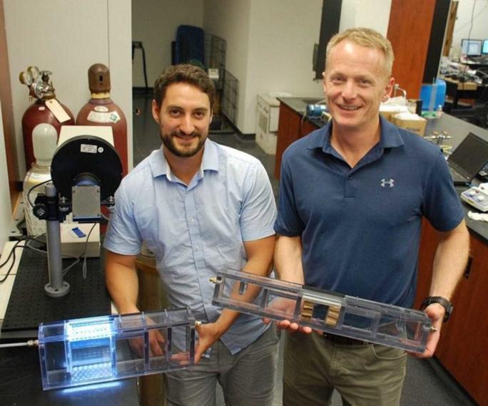 Bill Van Heyst and postdoc David Wood holding prototypes