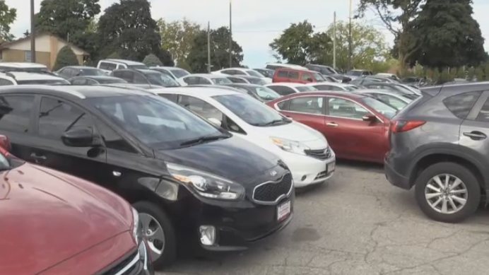 A photo of multiple parked cars.
