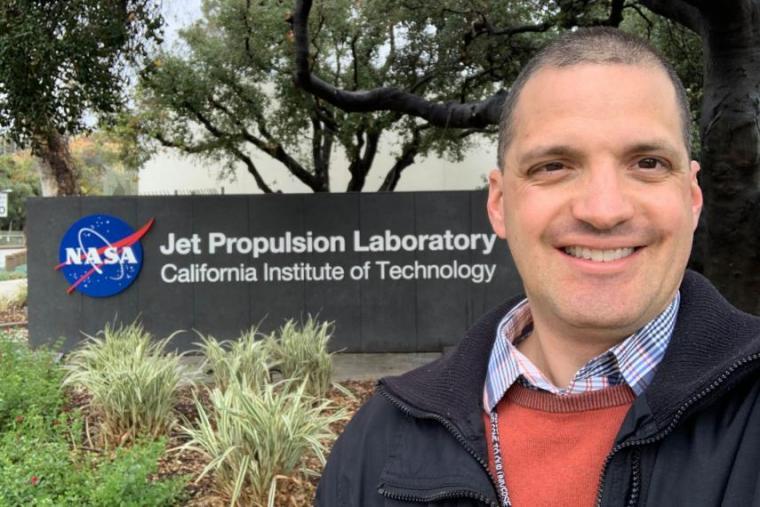 Headshot of Chris Heirwegh next to NASA sign