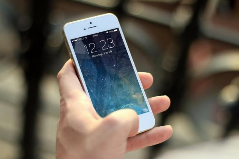 Image of person holding smartphone