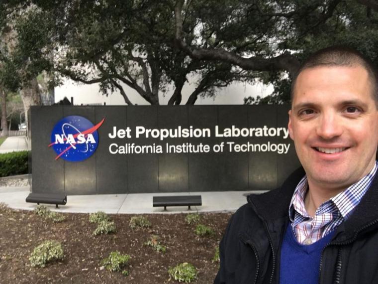 Chris Heirwegh next to NASA sign