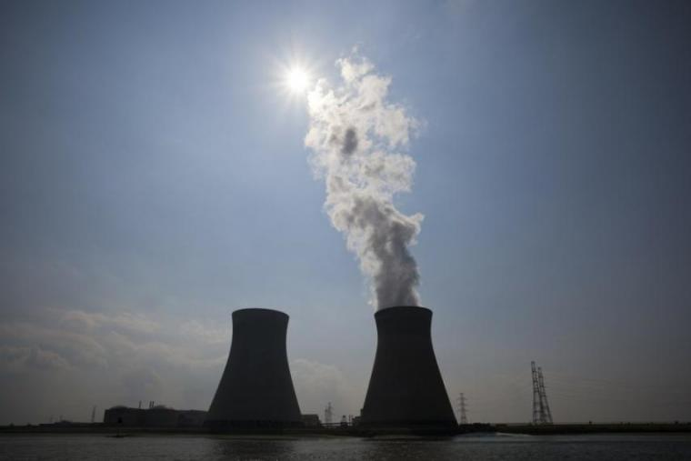 Nuclear power image with smoke coming out of smokestack