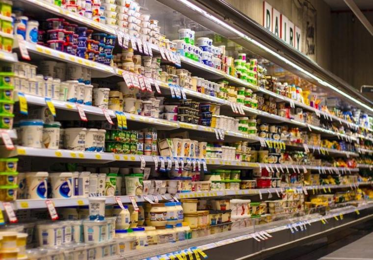Grocery store aisle with stocked shelves