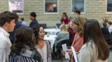 Catharine Dang and Mary Wells chat during reception