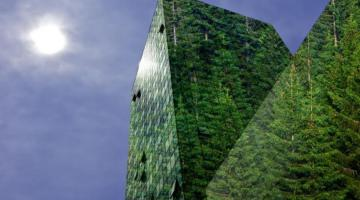 Photo of a set of buildings that show trees reflected in their windows.