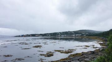 Image of Rigolet, Nunatsiavut from across the water on a cloudy day