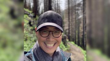 Headshot of Edward Kim hiking in mountains