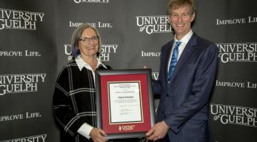 John Runciman presenting Professor Emerita Valerie Davidson with 2019 Director's Award of Distinction