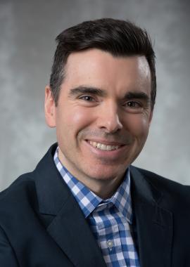 Headshot of Andrew Binns