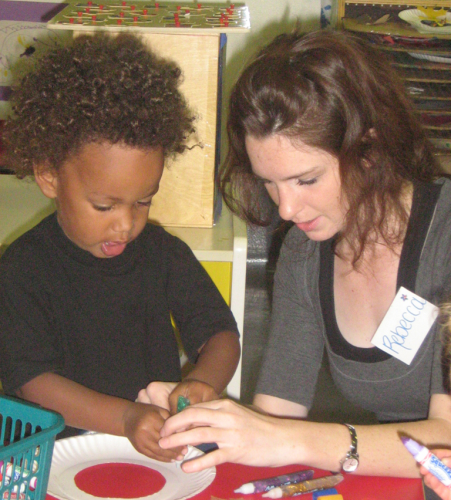 decorative image of student working with a child