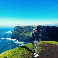 Student standing at the Cliffs of Moher, Ireland