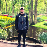 Student stands in front of the world's largest garden in the Netherlands
