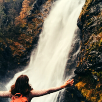 Student in front of a waterfall in Norway