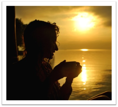 Student at sunrise with coffee