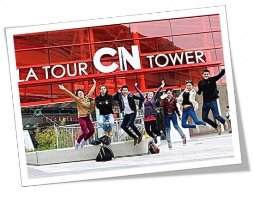 Photo of students jumping outside the CN tower sign