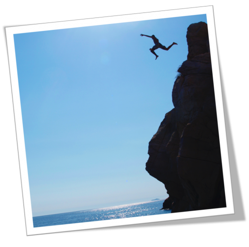 Person jumping off a cliff
