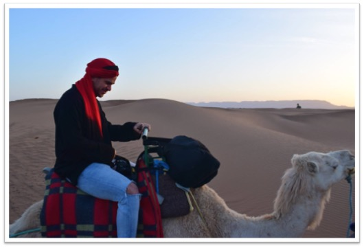 Photo of a student on a camel
