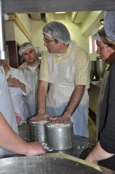 Professor Art Hill teaching cheese making course in pilot plant